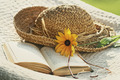Close up of straw hat, sunglasses and book on a hammock - PhotoDune Item for Sale