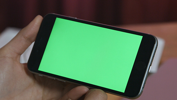 Girl Holding Smartphone with Green Screen