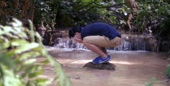 Asian Man Washing Face