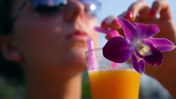 Smiling Woman Drinking Fresh Juice Outdoors