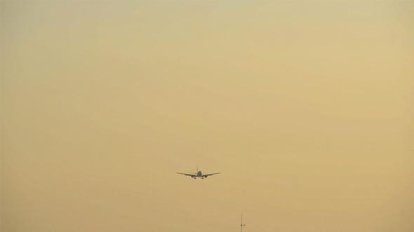 Plane Landing after Sunset