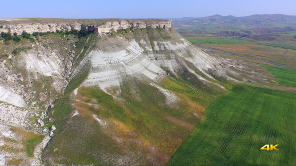 Aerial Flying Eroded Mountains and Slopes 1
