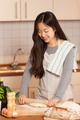 Asian woman is baking bread in her home kitchen - PhotoDune Item for Sale