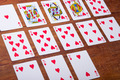 Playing cards on wooden background,playing cards for valentines day - PhotoDune Item for Sale