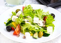 Greek salad on a table in a restaurant - PhotoDune Item for Sale