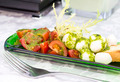 Caprese salad with tomatoes and cheese in a plate of glass - PhotoDune Item for Sale
