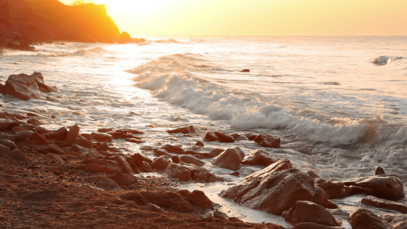 Golden Dawn on the Rocky Shore
