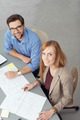 Young Business People Smiling at Camera in Meeting - PhotoDune Item for Sale