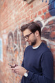 Young man sending a text message on smart phone - PhotoDune Item for Sale