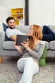 Attractive woman showing her tablet to her husband - PhotoDune Item for Sale