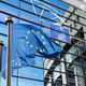 European Union flag against European Parliament - PhotoDune Item for Sale