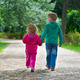 Little brother and sister walking by footpath - PhotoDune Item for Sale