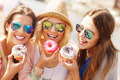Group of friends eating donuts in the city - PhotoDune Item for Sale