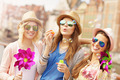Group of friends blowing soap bubbles - PhotoDune Item for Sale