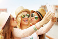 Three joyful friends taking selfie in the city - PhotoDune Item for Sale