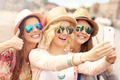 Three friends taking selfie in the city - PhotoDune Item for Sale
