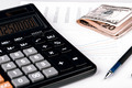 Business Charts with calculator, money and pen - PhotoDune Item for Sale