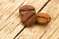 Coffee beans on old table - close up shot - PhotoDune Item for Sale