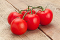 Bunch of red tomatoes on wooden table - studio shot - PhotoDune Item for Sale