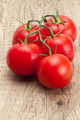 Bunch of red tomatoes on rustic wooden table - PhotoDune Item for Sale