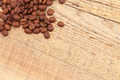 Coffee beans over old wooden table - close up shot - PhotoDune Item for Sale