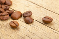Coffee beans on old wooden table - close up studio shot - PhotoDune Item for Sale