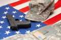 USA flag with handgun and US army uniform over it - PhotoDune Item for Sale