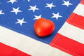 USA flag with toy heart over it - studio shot - PhotoDune Item for Sale