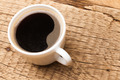 Cup of black coffee on old wooden table - PhotoDune Item for Sale