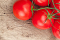 Bunch of red tomatoes on rustic wooden table - close up studio shot - PhotoDune Item for Sale