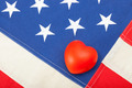 Neat USA flag with toy heart over it - studio shot - PhotoDune Item for Sale