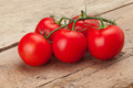 Red tomatoes on wooden table - studio shot - PhotoDune Item for Sale