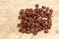 Coffee beans over old wooden table - PhotoDune Item for Sale