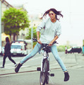 Colorful outdoor portrait of young pretty fashion model with bike. sexy woman posing in summer - PhotoDune Item for Sale