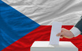 man voting on elections in czech in front of flag - PhotoDune Item for Sale