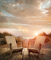 Wooden deck with chairs, sand dunes and ocean - PhotoDune Item for Sale