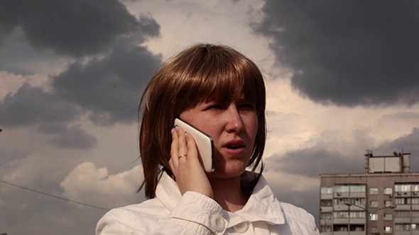 Girl Speaking On The Mobile Phone Emotionally