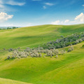 landscape with hilly field and blue sky - PhotoDune Item for Sale