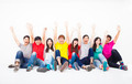Happy young group sitting together against white wall - PhotoDune Item for Sale