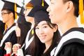 asian female college graduate at graduation with classmates - PhotoDune Item for Sale