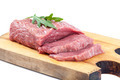 Meat on a cutting board on white background. - PhotoDune Item for Sale
