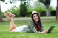 Beautiful young woman using digital tablet in the park. - PhotoDune Item for Sale