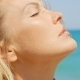 Blond Woman Enjoying Warm Sunshine On Beach - VideoHive Item for Sale