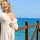Blond Woman Wearing Light Sweater On Windy Pier - VideoHive Item for Sale