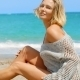 Woman Wearing Grey Sweater Sitting On Sandy Beach - VideoHive Item for Sale