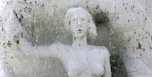Waterfall and Ancient Marble Stone Woman Statue