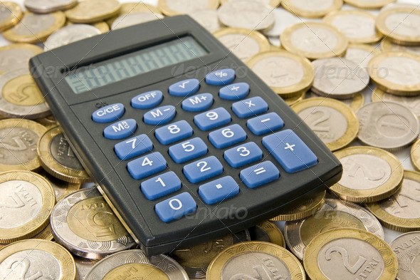 Calculator With Coins - Stock Photo - Images