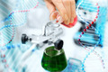 close up of scientist filling test tubes in lab - PhotoDune Item for Sale