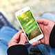 iPhone PSD mockup in Centra Park - GraphicRiver Item for Sale