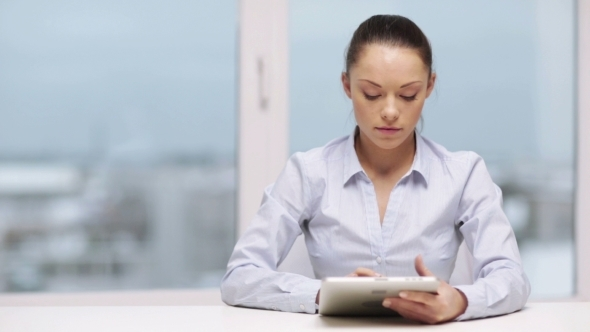Business Woman With Tablet Pc In Office